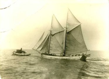 Schooner and tug