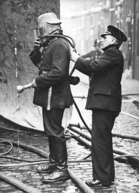 Fireman with smoke helmet